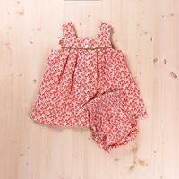 Imagen de Vestido bebé flor naranja tirantes y braguita