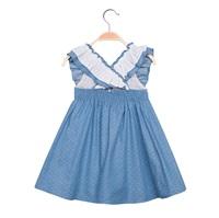 Image de Vestido de niña en azul con topos y volantes
