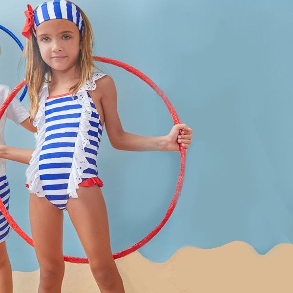 Image de Bañador de niña con rayas marineras y lazo