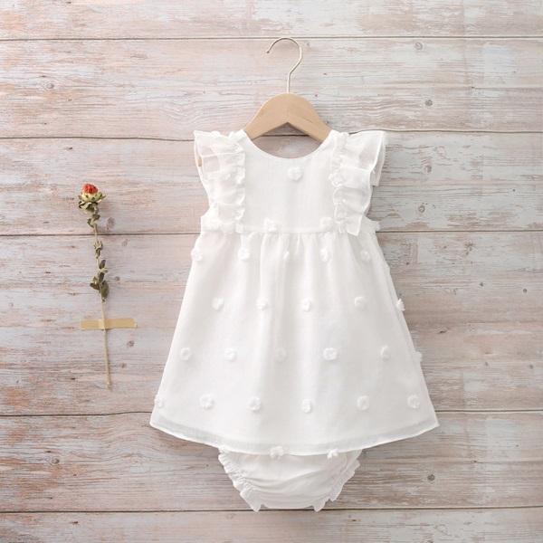 Imagen de Vestido bebé con pompones en relieve blanco