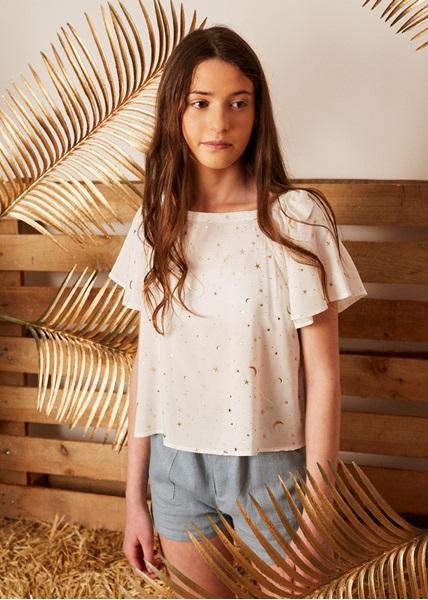 Imagen de blusa teen cuello barco con dos lazos en el hombro tejido estrellas