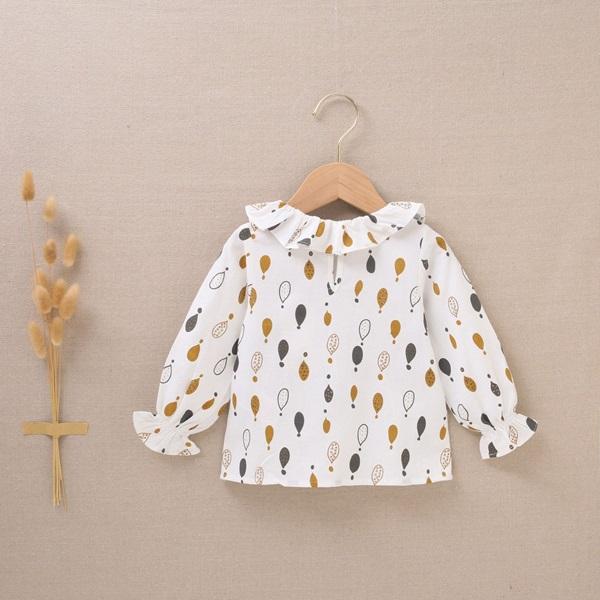 Imagen de Blusa de bebé niña estampado de gotas mostaza gris
