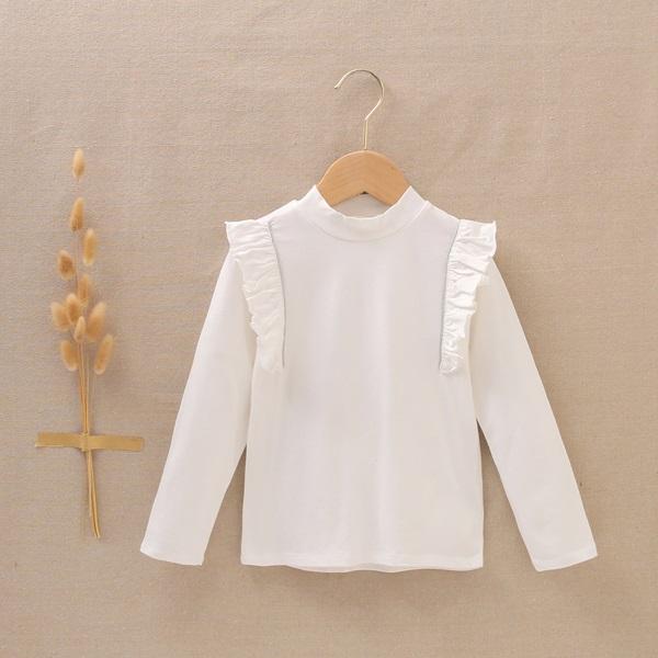 Imagen de Camiseta blanca de niña con volantes laterales y cinta plata